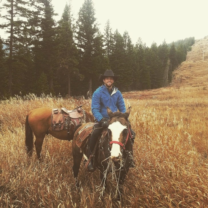 Riding into the mountainous valley around Clinton on my horse 'Cher'.