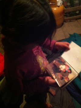 One of the daughters showing me the family albums