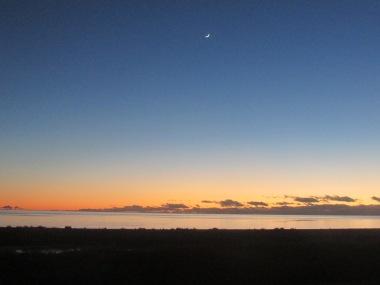 Sun rise over a still Antartic Ocean